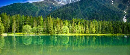 Beautiful view of an alpine lake Фото со стока