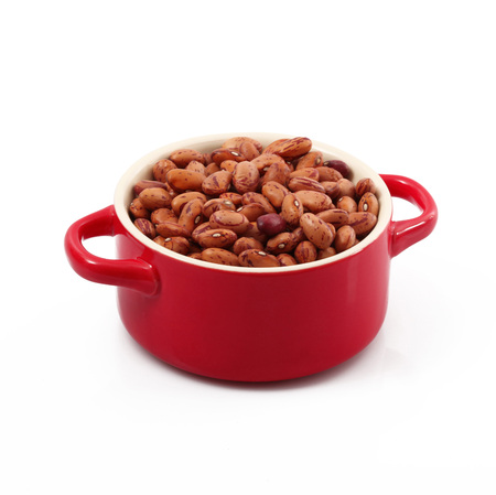 dry beans in pot on white background