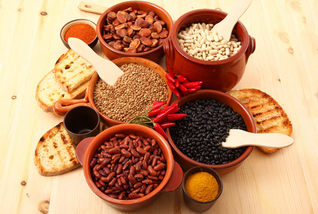 dry legumes in rustic dish on wooden table