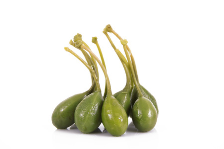 fresh capers on white background