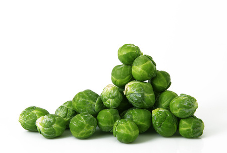 fresh brussels sprouts on white background
