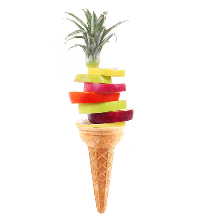 fresh fruit slices like an ice cream on white background
