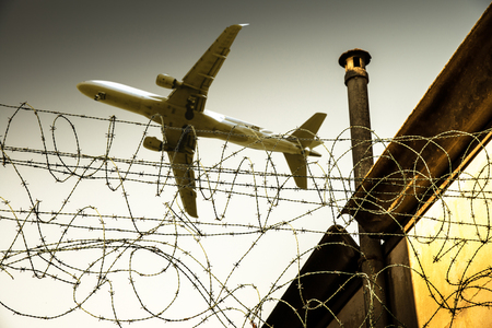 an Airplane flying over a prison