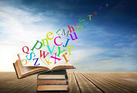 alphabet with books on sky background