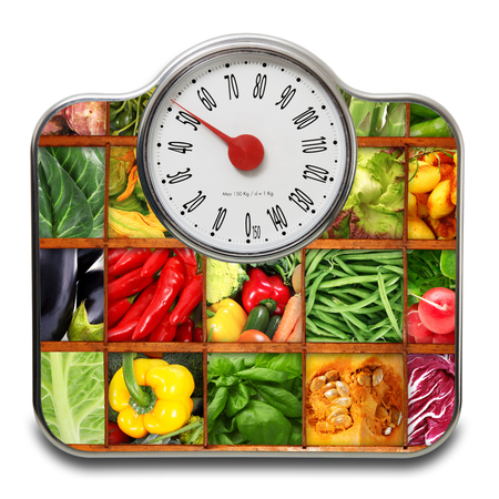 Scales for people with fruit and vegetables on white background