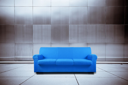 blue sofa on metal background