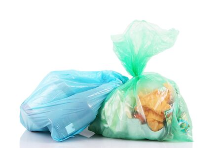 bags full of garbage on white background