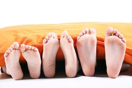 six feet under the blanket on white background