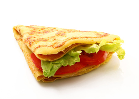 crepes with salad and tomatoes on white background