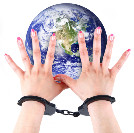 the planet Earth with hands and handcuffs