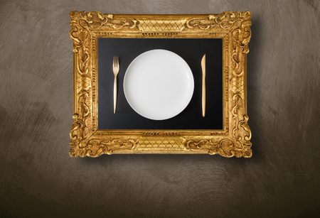 empty dish in frame hanging on wall
