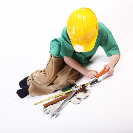 Young worker playing with tools for work