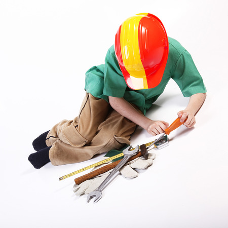 Young spanish worker playing with tools for work