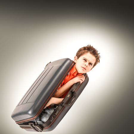 a boys locked in a suitcase Stock Photo