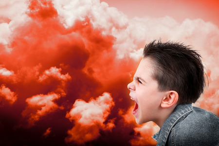 a young boy in anger Stock Photo