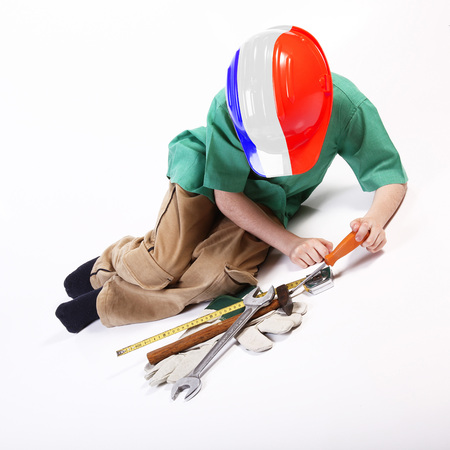 Young french worker playing with tools for work Stock Photo