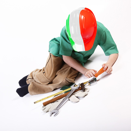 Young italian worker playing with tools for work