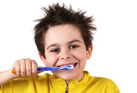 little boy is brushing his teeth