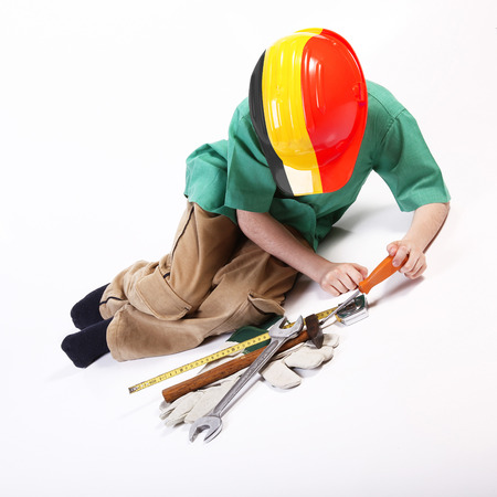 Young german worker playing with tools for work