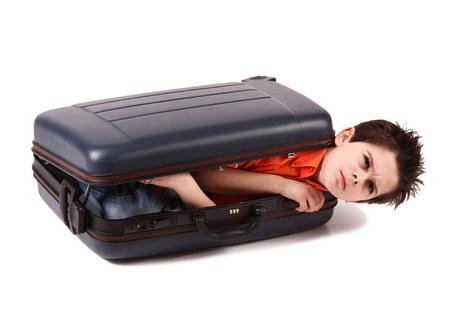 a boy locked in a suitcase