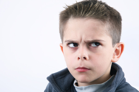 angry young boy on white background Stock Photo
