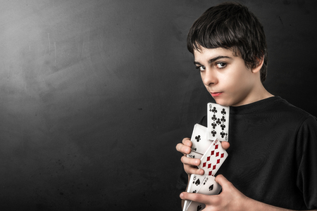 Young magician with playing cards