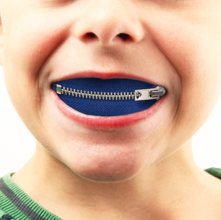 boy with zipper in mouth