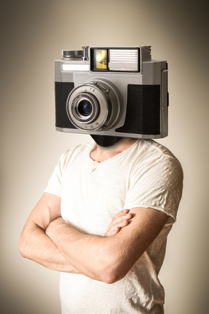 a man with a camera head
