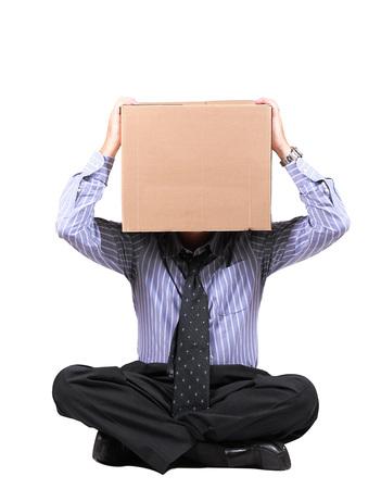 businessman with a carton box on the head