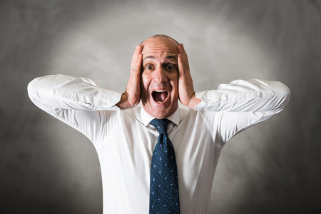 Stressed man with his head in his hands
