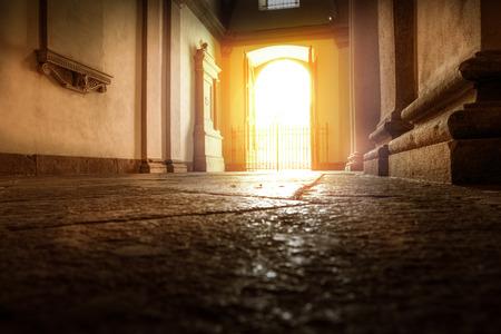 a Ancient sun-lit doorway seen from the inside