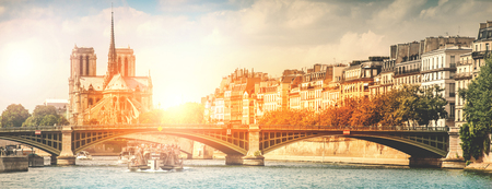 View of the city of Paris from the Seine at sunset