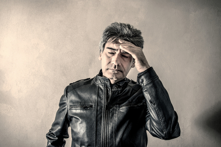 a Very tired and worried man Stock Photo