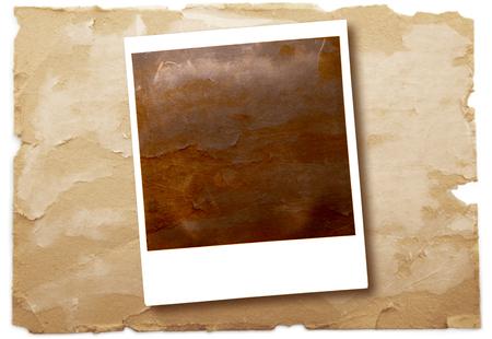 an original polaroid on vintage paper background