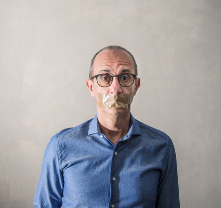 a Man with duct tape on mouth