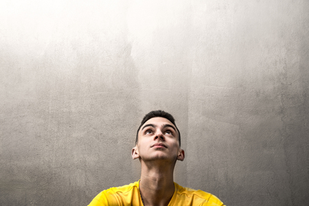 a Young man looking up Stock Photo