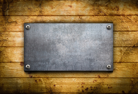 an industrial metal plate on a wooden background