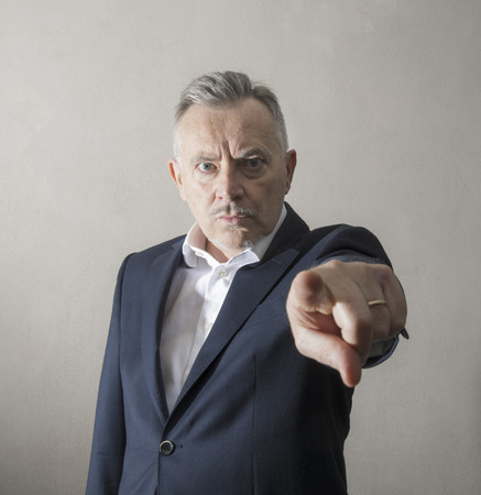 a man by Stern and angry look