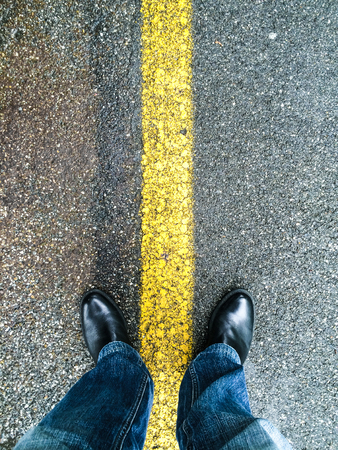 standing on an asphalt floor