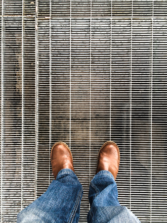 standing on a metal grate