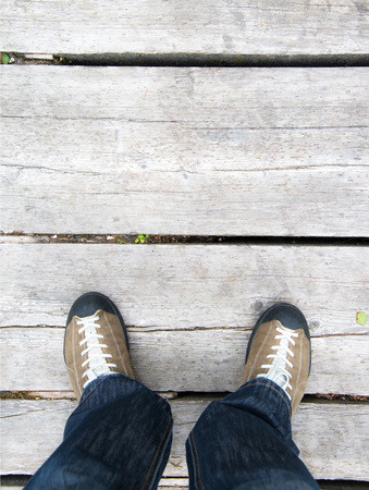 standing on a wood floor
