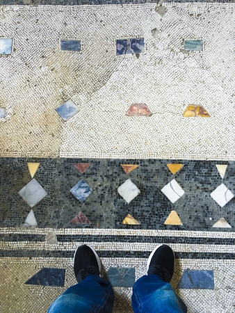 standing on an ancient Roman floor Stock Photo