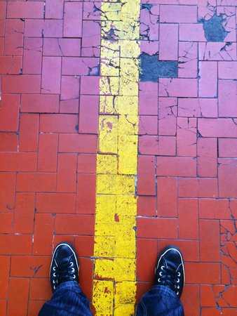standing on a floor of red tiles
