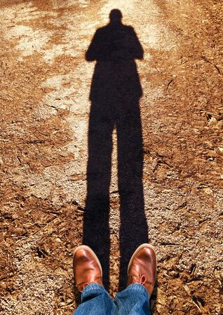 standing on the asphalt with a shadow