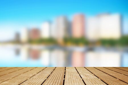 a urban blurred landscape with wooden terrace