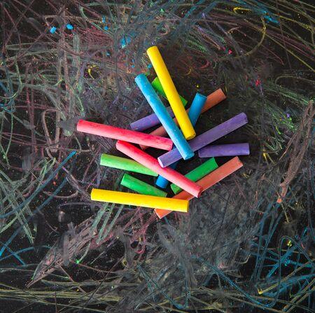 coloured chalks on black background