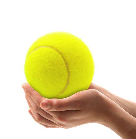 hands holding a yellow tennis ball
