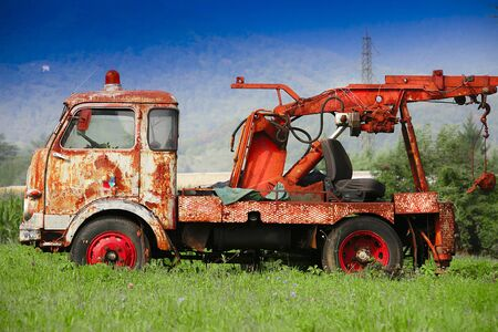 an old truck abandoned in a meadow Stock fotó