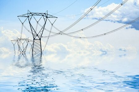 an high-voltage pylon in the middle of the water Standard-Bild