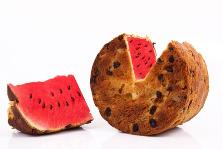 italian strange panettone and watermelon on white background